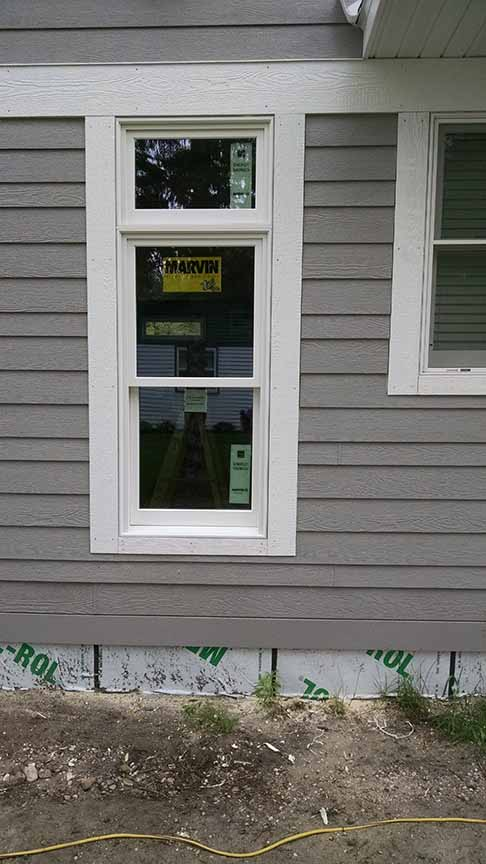Window replacement on a lake home